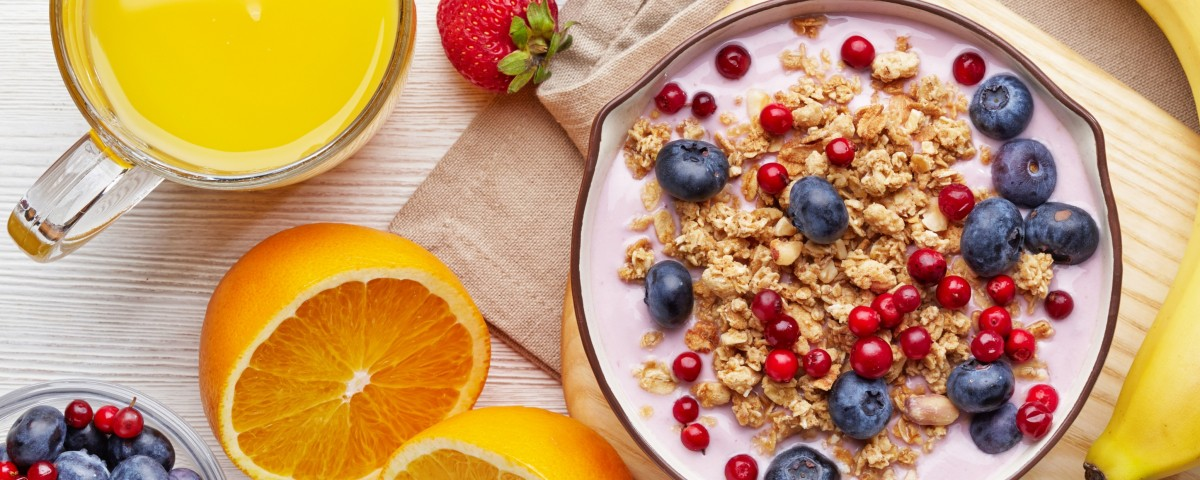 Healthy breakfast. Bowl of yogurt with granola and berries